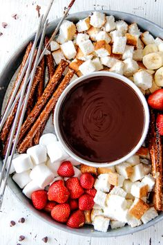 Slow Cooker Chocolate Fondue - EASY, velvety chocolate is the perfect make ahead party or special occasion appetizer or dessert. Perfect for Valentine's Day or baby/bridal showers!