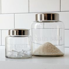 Apothecary Jars are a great way to organize your bathroom and get rid of unsightly packaging taking up space in your cabinets.