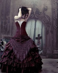 Maroon colored dress with a burgundy v-shaped drop sash in the front, with a stunning backdrop...