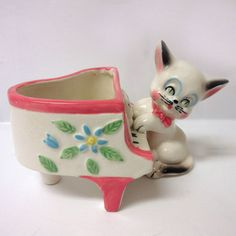 "Rare, 1950's, Shafford Japan porcelain novelty planter in the form of a cat, wearing a pink bow tie, and playing the piano. Signed on the bottom ""Hand Decorated Shafford Japan"" (see photos). 