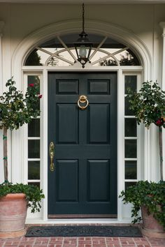 Vary up the greenery with some potted as well as planted flowers and plants. Potted plants can be great to accent either side of the front door. Additionally, lanterns are a great front porch accessory that can double as an additional light source. Front Door Entrance, House Front Door, Glass Front Door, Front Door Decor, Entry Doors, Front Porch, Front Door Side Windows, Front Hallway, Room Doors