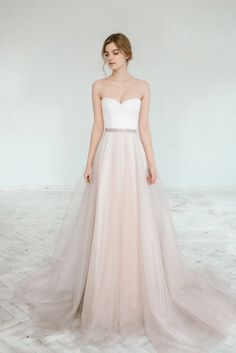 Two piece wedding dress with a blush wedding skirt and strapless, sweetheart neckline top