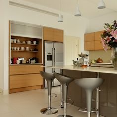 Grey kitchen with wooden cabinetry