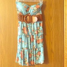 Blue Floral Print Strapless Dress with Belt Blue floral print strapless dress with brown belt in the front. Great condition, only worn once. Padded cups in the chest area, made of 100% Rayon. Dresses Strapless