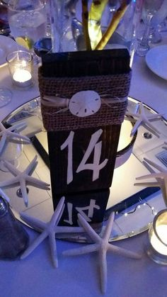 Purchase these handmade table numbers to add the perfect touch to your wedding!  Each table number is stained a deep brown. I then paint the number and