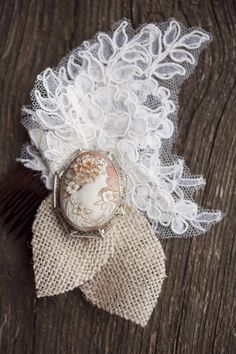 How sweet is this! lace and burlap with a cameo... maybe for the mother of the bride.