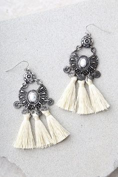 Wedding Earrings Summon up a stylish look with the Ancient Ritual Silver and Cream Tassel Earrings! Cream threaded tassels dangle beneath engraved silver settings with white marbled stones at the centers. White Tassel Earrings, Tassel Earing, Cream Earrings, Tassel Jewelry, Black Earrings, Silver Hoop Earrings, Bohemian Jewelry, Beaded Earrings, Silver Jewelry