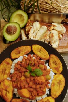 Rice & Beans with Roasted chicken, avocados and tostones or platanos maduros (seen here) add up to a perfect meal.