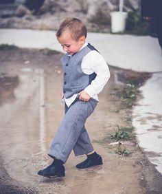 I love your wedding because mud puddles are fun... #ringbearer #weddingfun #rainydaywedding #weddingphotoinspiration #mudpuddles #littleboys #lookingsharp #anneedgarphoto