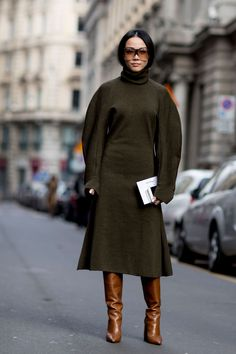 Khaki brown wollen felt dress, must be a Viktoria Beckham design, full length sleeves, turtleneck and a a-line midi skirt paired with cognac coloured knee high boots