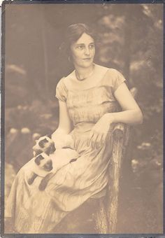 Woman with two Siamese cats, sepia photo