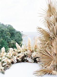 This dried flower backdrop for a destination wedding villa ceremony is giving us life! With a sun-kissed ocean view, a soft pink tablescape and natural decor elements scattered throughout, this Thailand wedding inspiration is all things glorious! See it all on Ruffled now. #phuketwedding #infinitypoolwedding #filmweddingphotographer Phuket Wedding, Thailand Wedding, Destination Wedding, Modern Wedding Flowers, Boho Wedding, Flower Makeup, Ivory Roses, Flower Backdrop, Nature Decor