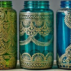These henna wedding mason jar lanterns make great boho wedding decor! Choose one henna painted vase in your favorite color for wonderful henna wedding decor, or choose all three for colorful mason jar table decor. This listing is for one 32 oz (quart sized) hand painted mason jar vessel. You choose from the three jars pictured, either grass green glass, peacock green glass, or turquoise glass. See a design you like but want a different glass color? No problem! Just choose the jar with the…