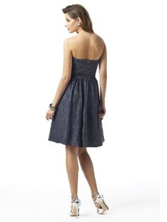The waist is defined as the surplice bodice fits perfectly next to the body. With a short skirt, Dessy Bridesmaids 2865 gives a great look to the fabulous legs and great looking heels! Dress available in oyster, charcoal gray or black lace over any color matte satin. #timelesstreasure