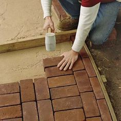 DIY:  How to Lay a Brick Pathway - everything you need to know about correctly installing a brick pathway is on this post + plus a link to watch a video tutorial - via ThisOldHouse.com