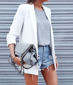 White blazer + cutoff shorts.