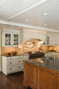 White cabinets, cherry island, paneled ceiling.  Hmmmm.