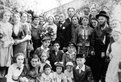Eva Galler's half-brother, Morris, married Dora, then living in the United States, who returned to Poland to find a suitable husband. The couple left Poland just before the outbreak of war. Left to right standing: Eva, then 15, is at the extreme left. Skip two, then her father Israel and mother Ita Vogel. Skip one, Dora in veil with Morris. Then Eva's half-brother Hirsh. Skip to Eva's Uncle Abraham Vogel in hat at right. Left to right seated: a niece, then sister Hannah. Sitting in front…