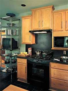 Raise cabinet over stove.