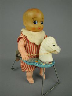 vintage wind up baby horse tin toy from Japan