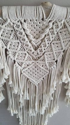 Make a statement in your home with this stunning macramé wall hanging. Created from light ivory rope and driftwood found on the coast of California, this beautiful piece is full of detail and layers. This item is made to order and will vary slightly from the photos above. I do my best to