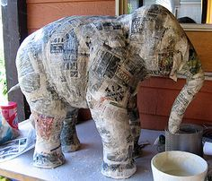 Paper Mache Elephant,  included on the site is a great recipe for paper mache clay,  which is good for modeling fine details