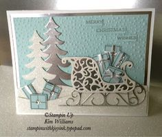 """Here's my contribution. I was in a super sparkly mood today and it shows.  I created this dazzling card with the """"Santa's Sleigh"""" stamp set and """"Santa's Sleigh"""" Framelits dies. The detail of this set is amazing to say the least. I've used soft sky and whisper white cardstocks, along with the silver foil sheets and dazzling diamonds glimmer paper. The ink is smoky slate, but it reminds me of silver in color.. just not as shiny. Here's a close up of the sparkle and details. The """"Santa's…"""