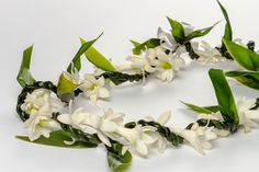 7 of Hawaii's most popular lei, and what makes them unique Red And Green Make, Orchid Lei, Ti Plant, Singular And Plural, Flower Lei, Purple Orchids, Hawaiian Flowers, Hawaii Vacation, Beautiful Necklaces
