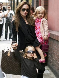 Angelina Jolie always looks classic in black! Here she is with her daughter in a pink floral dress!