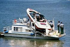 STRANGE BOATING DANGERS - RACING SPEED BOAT CRASHES INTO HOUSEBOAT - ENDS UP ON TOP OF BOAT!