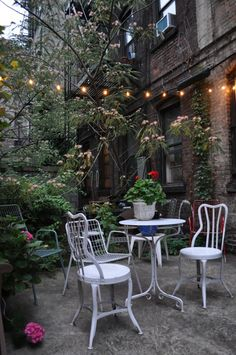 Lights make a courtyard useful into the evening.