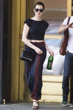 Just another day: The 31-year-old Oscar winner looked fresh and chic for her stroll, carry...