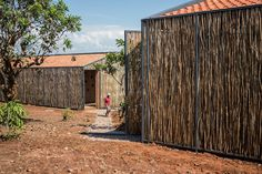 """Built by Sharon Davis Design in Rwinkwavu, Rwanda with date Images by Bruce Engel. Two new """"Share Houses"""" – designed by New York City-based Sharon Davis Design, in partnership with Rwanda Village Ente. Healthcare Architecture, Sustainable Architecture, Contemporary Architecture, Art And Architecture, Sharon Davis, Health Farm, Science Park, Community Space, Farm Stay"""