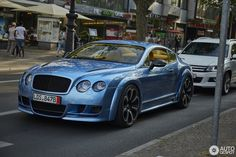 Bentley Hamann Imperator GT 2 bentley continental GT blue with yellow and black interior gold diamond stitch