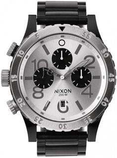 Nixon 48-20 Black/ Silver A486-180 - Dameklokker - Denne klokken er produsert av amerikanske Nixon, kjent for unik og robust design har de tatt markedet med storm de siste årene. Her får du designerklokker i topp kvalitet som virkelig skiller seg ut!
