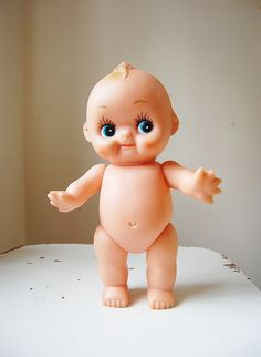 Kewpie Doll...I still have the one my gma had. I remember her making me play diapers for her out of kleenex.
