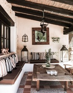 S'Arracó Outdoor Seating Area with a built in banquette with an upholstered cushion and decorative throw pillows