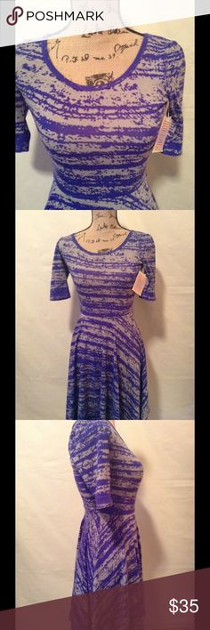 NWT Lularoe Nicole Dress NWT purple and gray abstract pattern. Lightweight knit slip over style. Size XXS LuLaRoe Dresses Midi