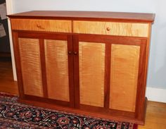 http://www.bissellwoodworking.com/cases/p7IGM_images/fullsize/4-panel-sideboard_fs.jpg