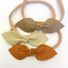 Hand cut and tied real leather knot bow. Bows measure 2.5, PETITE. You can have the bow attached to a clip or one size fits all soft nylon elastic.