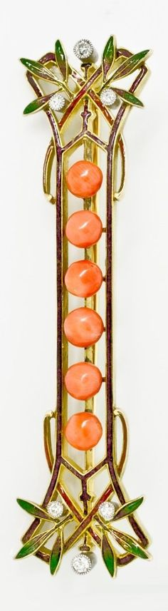 An Art Nouveau 18k gold, enamel, coral and diamond brooch, French, 1900s. 2 inches long. #goldbrooches #GoldJewelleryArtNouveau