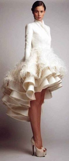 The way the ruffles and feathers create the perfect flounce. Gorgeous