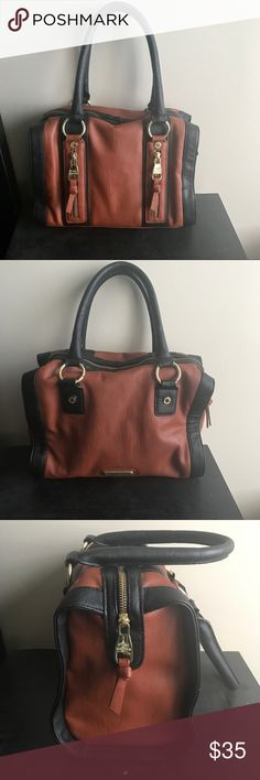 Steve Madden shoulder purse I love this purse! Designed with a deep caramel brown and a dark navy with gold accessorized accent colors! Perfect for your every day needs and extremely stylish! A must have ladies! Steve Madden Bags Shoulder Bags