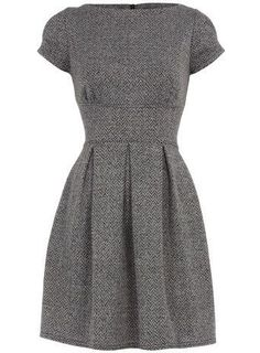Love this warm winter dress. Modest enough for the office, but would be great for a party dressed up with some bold accessories.