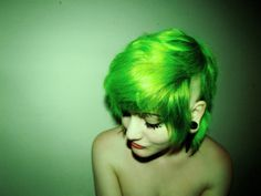 Besides the fact that she looks naked.. That hair color is stunning. neon green hair