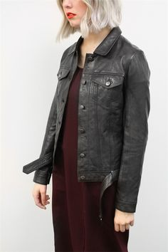 This leather jacket is exceptionally soft with a distressed, vintage feel. The classic cut has a defined waist and metal buttons. It fastens with a belt that buckles along the hem. A timeless addition to every winter wardrobe. Winter 2016 Size & Fit: Model is 177cm tall Model wears a NZ 8/ NZ S/ EU 36/ US 4 Wash Guide: Dryclean only. Select a high quality leather drycleaner. Gentle short cycle. Low moisture cool temperature. Do not wring/drip dry. Do not allow to be exposed to direct sun...
