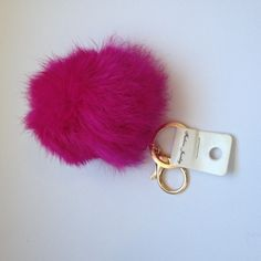 """Faux Rabbit Fur Pom Pom Keychain Hot Pink Faux  Rabbit Fur Pom Pom Keychain Hot Pink is 3"""" with a 1"""" chain with a latch and a keychain loop on the end. Only 1 available in Pink. Look for Grey in other listing. Accessories Key & Card Holders"""