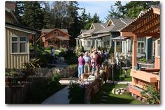 """Ross Chapin Architects. Another """"Pocket Neighborhood"""" of small and smaller :-D houses carefully planned to allow the community feeling to happen with shared common grounds and """"soulless"""" garages behind the houses where they don't give that shut off feeling."""