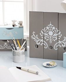 With cool gray tones and icy blues, this suite of desk accessories will add a sophisticated edge to your workspace.