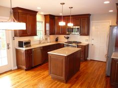 kitchen remodel, wood floors, glass subway tile back splash, island, pendent lighting